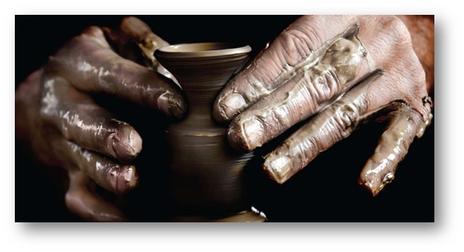 Hands forming clay jar