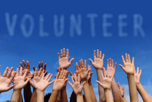 Volunteers with hands raised
