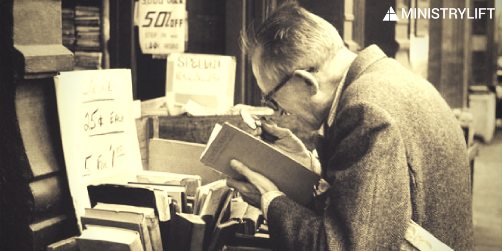 men reading with magnifying glass