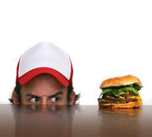 Man looking at hamburger - fasting