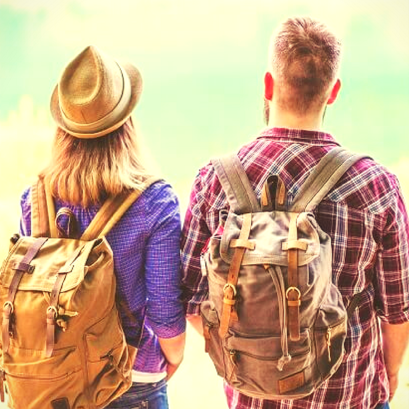 Young couple with backpacks